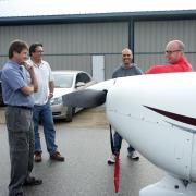 Club member/pilots comparing notes on the finer points of Cardinal flying.